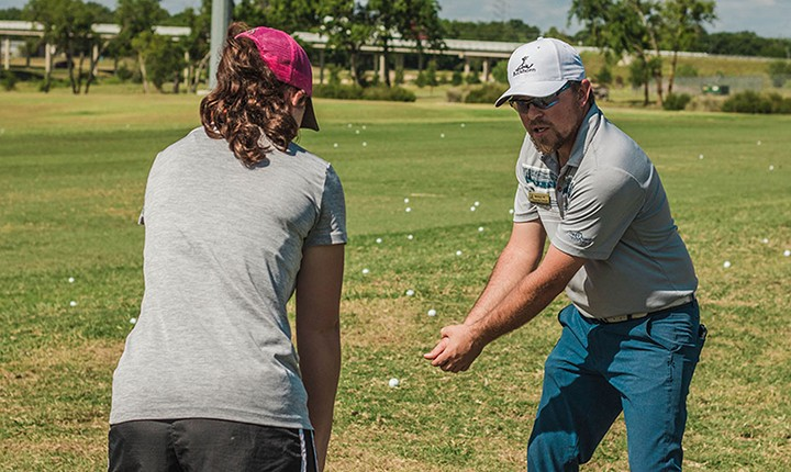 golf instructor demonstrating a golf swing